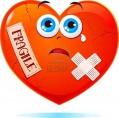 9893145-corazon-roto-con-la-etiqueta-fragil