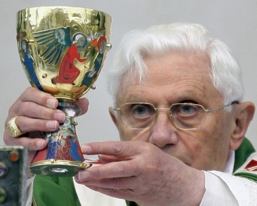 Pope Benedict XVI  holds the cup of blessed wine as he leads a mass in Brescia