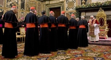 Pope Benedict XVI addresses cardinals for Christmas wishes in in the Clementine Hall at the Vatican