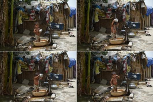 This combination of images created on May 28, 2015, shows a young Indian child as he bathes at a waterpump in an attempt to keep cool in New Delhi.  More than 1,100 people have died in a blistering heatwave sweeping India, authorities said, as forecasters warned searing temperatures would continue. AFP PHOTO/MONEY SHARMA