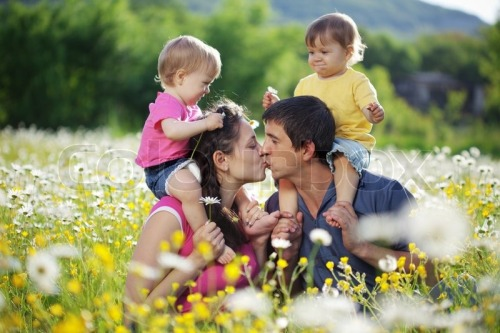 2844280-happy-young-family-with-twins-resting-outdoors