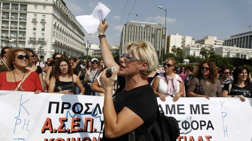 "Workers for the ""Help and Home"" programme ''shout slogans during a protest outside the Greek parliament in Athens, Friday, Sept. 30, 2011. The program created to encourage the elderly and disable people in their health care but most of the workers remain unpaid the last nine months. The inspectors from the International Monetary Fund, European Central Bank and European Commission returned to Athens this week after suspending their review earlier this month over missed targets and delayed implementation of reforms. Their approval is critical for Greece to receive the next euro 8 billion installment of its euro 110 billion ($150 billion) bailout loan package agreed on last year. (AP Photo/Petros Giannakouris)"