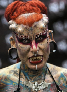 A tattooed woman poses for a picture during the opening of the XV International Tattoo Expo in Monterrey, Mexico on March 3, 2013. AFP PHOTO/Julio Cesar AGUILAR
