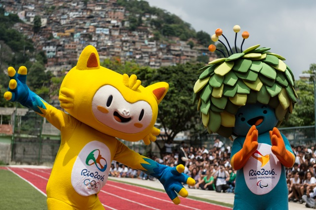 The new mascots for the Rio 2016 Olympic Games (L) and the Rio 2016 Paralympic Games, are presented at the Ginasio Experimental Olimpico Juan Antonio Samaranch in Rio de Janeiro, Brazil, on November 24, 2014. The Rio Olympic Games have their mascot, a yellow feline animal representing Brazil's rich fauna and wildlife, while the Paralympic Games mascot is a predominantly blue and green figure whose head of covered with leaves -- depicting once again the host country's rich vegetation as Brazil prepares to welcome the Olympics to South America for the first time. It remains only for the public to decide on a name, choosing from a range of options. AFP PHOTO / YASUYOSHI CHIBA