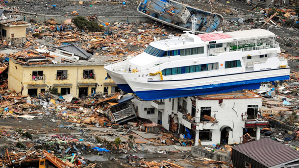 OTSUCHI, JAPAN - MARCH 15: (JAPAN OUT) A sightseeing ship is washed onto 2-story high building after an 9.0 magnitude strong earthquake struck on March 11 off the coast of north-eastern Japan, on March 15, 2011 in Otsuchi, Iwate, Japan. The quake struck offshore at 2:46pm local time, triggering a tsunami wave of up to 10 metres which engulfed large parts of north-eastern Japan. The death toll is currently unknown, with fears that the current hundreds dead may well run into thousands. (Photo by The Asahi Shimbun via Getty Images)