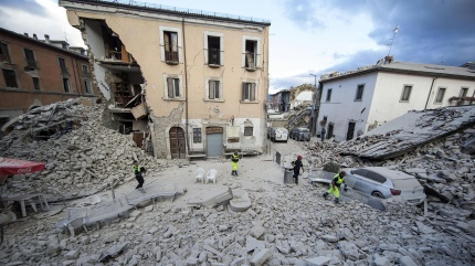 The side of a building is collapsed following an earthquake, in Amatrice Italy, Wednesday, Aug. 24, 2016. The magnitude 6 quake struck at 3:36 a.m. (0136 GMT) and was felt across a broad swath of central Italy, including Rome where residents of the capital felt a long swaying followed by aftershocks. (Massimo Percossi/ANSA via AP)