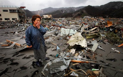 Reiko Miura, 68, cries as she looks for her sister's son at a tsunami-hit area in Otsuchi, Iwate Prefecture, northern Japan, Wednesday, March 16, 2011, after Friday's earthquake and tsunami. (AP Photo/Itsuo Inouye)
